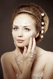 Woman with creative make-up of pearls Royalty Free Stock Photography