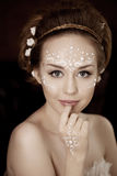Woman with creative make-up of pearls Stock Photography