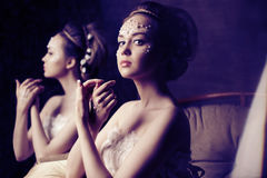 Woman with creative make-up of pearls stock images