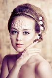 Woman with creative make-up of pearls royalty free stock images