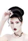 Woman with creative make up and snake in her hands Royalty Free Stock Photo