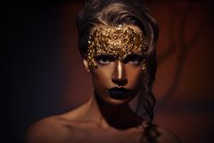 Woman with creative makeup against brown Royalty Free Stock Photos
