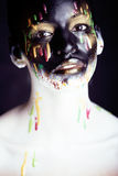 Woman with creative makeup closeup like drops of colors, facepai Royalty Free Stock Image