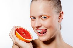 Woman with creative makeup and grapefruit Stock Photo
