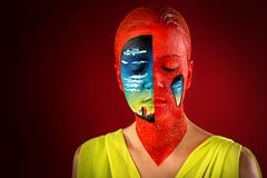 Woman art make up creative. Woman with creative makeup, portrait, face, shoulders. Against the background of the red black studio, sleep, hallucinations royalty free stock photo