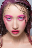 Woman with creative  pink colorful make-up Stock Photos
