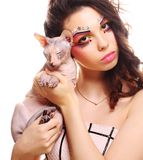 Woman with creative visage holding Sphynx cat Stock Photography