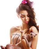 Woman with creative visage holding Sphynx cat Royalty Free Stock Photos