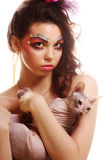 Woman with creative visage holding Sphynx cat Stock Photos