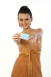 Woman with  credit card. Beautiful woman with rich gold color dress holding credit card Royalty Free Stock Images