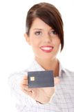 Woman with a credit card. On her hand Royalty Free Stock Image