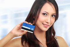 Woman with credit card Stock Photos