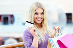 Woman with credit card Royalty Free Stock Photo