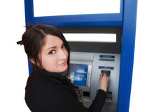 Woman with credit card. Woman withdrawing money from credit card at ATM royalty free stock image