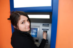 Woman with credit card. Woman withdrawing money from credit card at ATM stock photos