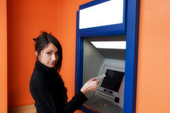 Woman with credit card. Woman withdrawing money from credit card at ATM stock images