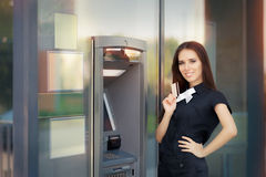 Woman with Credit Card at ATM cash machine Royalty Free Stock Image