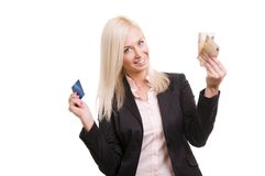 Woman with a credit card and cash in her hand Royalty Free Stock Images