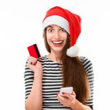 Woman with credit card on Christmas Royalty Free Stock Photos