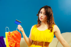 Woman with credit card doing shopping Stock Images