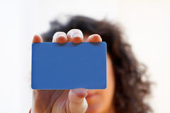 Woman with a credit card on her hand Stock Images