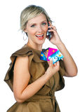 Woman with credit card and mobile phone Stock Photo