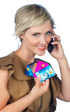 Woman with credit card and mobile phone Royalty Free Stock Photo