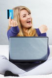 Woman with credit card paying over internet for online shopping, modern technology Royalty Free Stock Photos