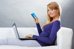 Woman with credit card paying over internet for online shopping, modern technology Stock Photography