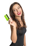 Woman with credit card. Portrait of beautiful cheerful woman with a credit card Royalty Free Stock Image