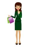 Woman with a credit card and purchases in hands Royalty Free Stock Photography