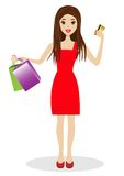 Woman with a credit card and purchases in hands Royalty Free Stock Photo