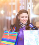 Woman with credit card shopping on the background of the street. Young woman with credit card shopping on the background of the street Stock Image