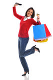 Woman with credit card and shopping bags. And holding a cell phone Stock Photos