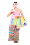 Woman with credit card and shopping bags Royalty Free Stock Image