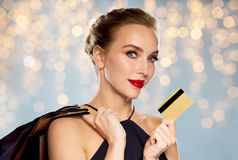 Woman with credit card and shopping bags Stock Photography
