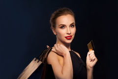 Woman with credit card and shopping bags Royalty Free Stock Photography