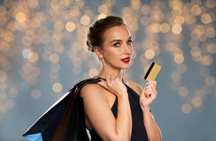 Woman with credit card and shopping bags Stock Image