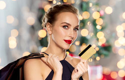 Woman with credit card shopping at christmas Royalty Free Stock Images
