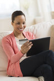 Woman With Credit Card Shopping On Digital Tablet At Home Stock Images