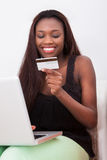 Woman With Credit Card Shopping Online At Home Stock Photography