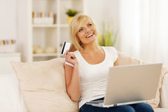 Woman with credit card Stock Images