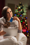 Woman with credit card and tablet pc near christmas tree Royalty Free Stock Photography