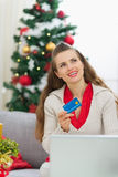 Woman with credit card thinking about presents Stock Image