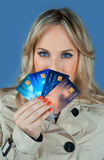 Woman with credit cards. Woman holding collection of credit cards Royalty Free Stock Photos