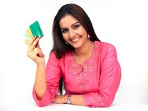 Woman with a credit cards. Beautiful young asian indian woman with a credit cards Royalty Free Stock Image
