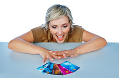 Woman with credit cards. Attractive woman with collection of credit cards making exited expression Royalty Free Stock Image