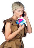 Woman with credit cards and mobile phone. Attractive woman with collection of credit cards talking on mobile phone Royalty Free Stock Photography