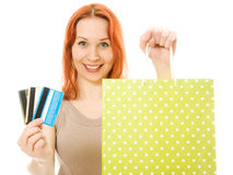 Woman with credit cards and shopping. Woman with many different credit cards and shopping isolated on white Royalty Free Stock Image