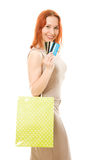 Woman with credit cards and shopping. Woman with many different credit cards and shopping. Isolated on white Stock Photo